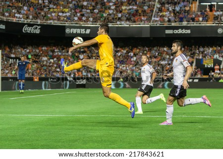 VALENCIA, SPAIN - AUGUST 29: Santa Cruz with ball at the Spanish League game between Valencia CF and Malaga CF at Estadi de Mestalla (Mestalla Stadium) on August 29, 2014 in Valencia, Spain - stock photo