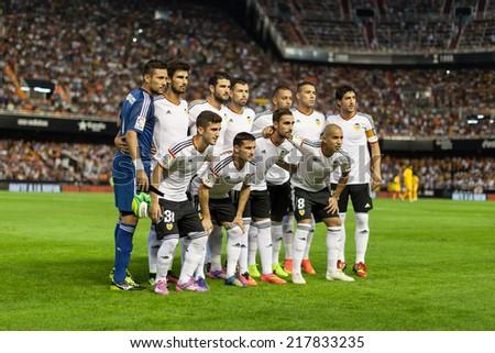 VALENCIA, SPAIN - AUGUST 29: Valencia players at the Spanish League game between Valencia CF and Malaga CF at Estadi de Mestalla (Mestalla Stadium) on August 29, 2014 in Valencia, Spain - stock photo