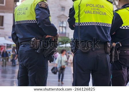 VALENCIA,SPAIN-CIRCA MARCH 2015: The policemen of Valencia city, keeping order in the streets