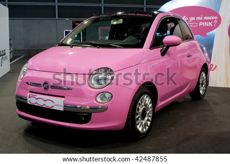 VALENCIA, SPAIN - DECEMBER 4: A 2009 Fiat 500 Pink Car at the 2009 Valencia Car Show on December 4, 2009 in Valencia, Spain. - stock photo
