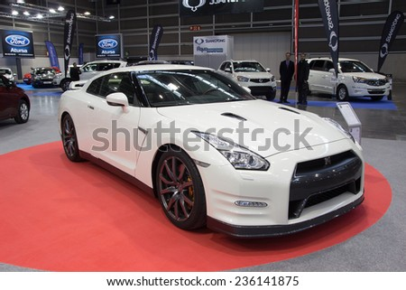 VALENCIA, SPAIN - DECEMBER 4, 2014: A white 2015 Nissan GT-R sports car at the Valencia Automovil 2014 Car Show. The Nissan GT-R is powered by the VR38DETT V6 engine.