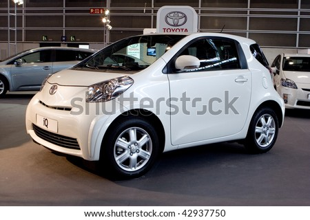 VALENCIA, SPAIN - DECEMBER 4: A 2009 White Toyota iQ City Car at the 2009 Valencia Car Show on December 4, 2009 in Valencia, Spain.
