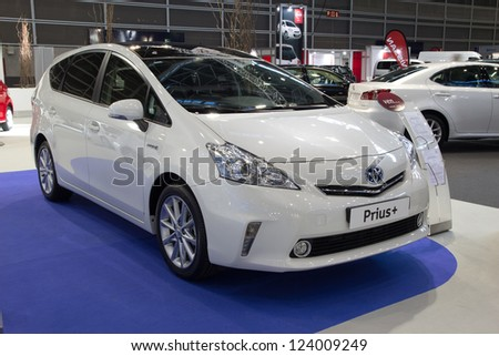 VALENCIA, SPAIN - DECEMBER 7 - A White 2012 Toyota Prius Hybrid Vehicle at the Valencia Car Show on December 7, 2012 in Valencia, Spain. - stock photo