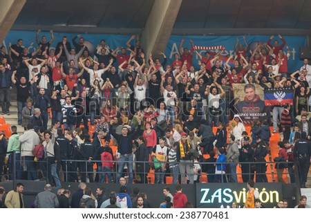 VALENCIA, SPAIN - DECEMBER 5: Crvena Zvezda supporters during Euroleague match between Valencia Basket Club and Crvena Zvezda Telekom Belgrade at Fonteta Stadium on Dicember 5, 2014 in Valencia, Spain - stock photo