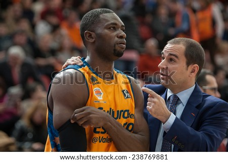 VALENCIA, SPAIN - DECEMBER 7:  (L) Sato during Endesa Spanish League game between Valencia Basket Club and Laboral Kutxa Baskonia at Fonteta Stadium on December 7, 2014 in Valencia, Spain - stock photo