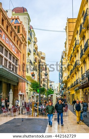VALENCIA, SPAIN, DECEMBER 30, 2015: people are walking through carrer de ribera street situated in the historical centre of spanish city Valencia