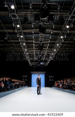 VALENCIA, SPAIN - FEBRUARY 3:  A model on the catwalk wears a Paco Roca design for the Valencia Fashion Week on February 3, 2010 in Valencia, Spain. - stock photo