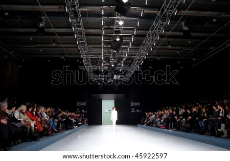 VALENCIA, SPAIN - FEBRUARY 3:  A model on the catwalk wears a Siglo Cero design for the Valencia Fashion Week on February 3, 2010 in Valencia, Spain. - stock photo
