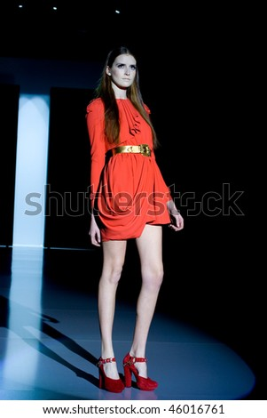 VALENCIA, SPAIN - FEBRUARY 3:  A model takes to the catwalk wearing a creation by Spanish designer Juan Vidal, presented at the 8th Valencia Fashion Week on February 3, 2010 in Valencia, Spain. - stock photo