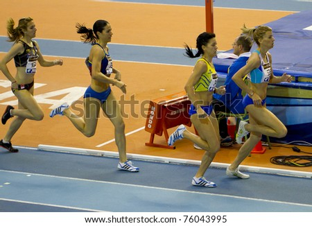 """VALENCIA, SPAIN - FEBRUARY 20: Competitor of 1500m women """"Macias Chow Isabel"""" at second place of the Spanish indoor national championships at Valencia on February 20, 2011 in Valencia, Spain - stock photo"""