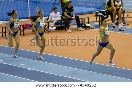 "VALENCIA, SPAIN - FEBRUARY 20: Competitors of 1500m women with ""Macias Chow Isabel"" at first place of the Spanish indoor national championships at Valencia on February 20, 2011 in Valencia, Spain"