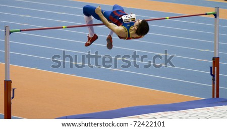 "VALENCIA, SPAIN - FEBRUARY 20: High jump competitor ""Javier Bermejo"" of high jump Men of the spanish indoor national championships at Valencia on February 20, 2011 in Valencia, Spain - stock photo"