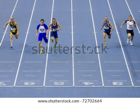 VALENCIA, SPAIN - FEBRUARY 19: Race of the Indoor track and field spanish national championship. Runners in the finish line of men's 60m sprint on February 19, 2011 in Valencia, Spain - stock photo