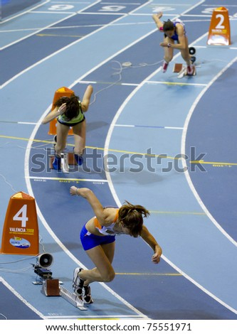 VALENCIA, SPAIN - FEBRUARY 19: Starting the 400m women race,with Hernandez Maria in the 4th lane during the Spanish Indoor National Championships at Valencia on February 19, 2011 in Valencia, Spain - stock photo