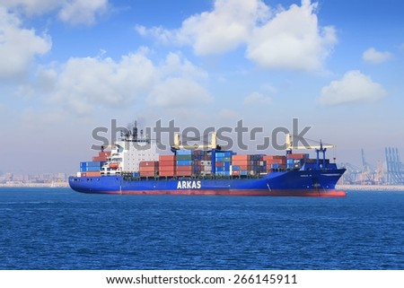 """VALENCIA, SPAIN FEBRUARY 05: The container ship """"GISELE A"""" anchored close to  the port of Valencia waiting for entering port, on February 05, 2015 in Valencia. - stock photo"""