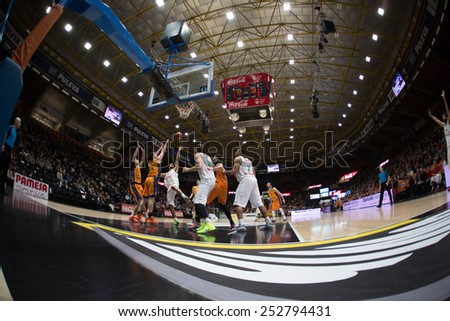 VALENCIA, SPAIN - FEBRUARY 11: Various players during Eurocup match between Valencia Basket Club and Lokomotiv Kuban Krasnodar at Fonteta Stadium on February 11, 2014 in Valencia, Spain - stock photo