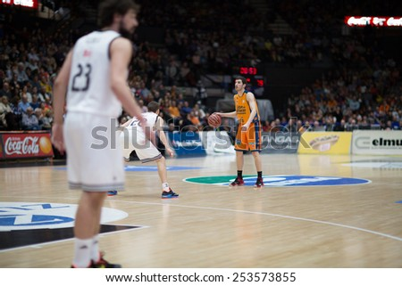 VALENCIA, SPAIN - FEBRUARY 15: Vives with ball during Spanish League match between Valencia Basket Club and Real Madrid at Fonteta Stadium on February 15, 2015 in Valencia, Spain - stock photo