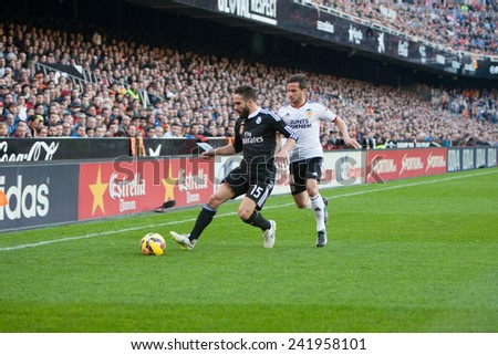 VALENCIA, SPAIN - JANUARY 4: Carvajal with ball and Piatti during Spanish League match between Valencia CF and Real Madrid at Mestalla Stadium on January 4, 2015 in Valencia, Spain - stock photo
