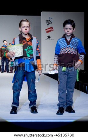 VALENCIA, SPAIN - JANUARY 23: FIMI Children's Winter Fashion Show with the designer AKR Kids on the runway in the Feria Valencia on January 23, 2010 in Valencia, Spain. - stock photo