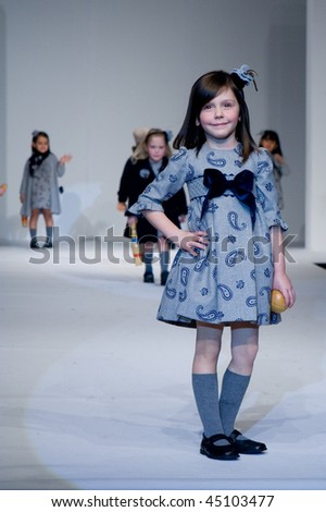 VALENCIA, SPAIN - JANUARY 23: FIMI Children's Winter Fashion Show with the designer Elisa Menuts on the runway in the Feria Valencia on January 23, 2010 in Valencia, Spain. - stock photo