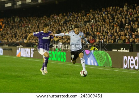 VALENCIA, SPAIN - JANUARY 4: Gaya with ball and Lucas during Spanish King Cup match between Valencia CF and R.C.D. Espanyol at Mestalla Stadium on January 4, 2015 in Valencia, Spain - stock photo