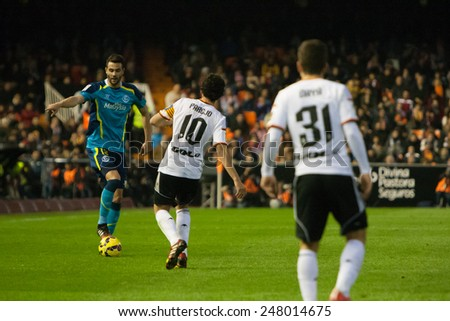 VALENCIA, SPAIN - JANUARY 25: Iborra with a ball and Parejo during Spanish League match between Valencia CF and Sevilla FC at Mestalla Stadium on January 25, 2015 in Valencia, Spain - stock photo