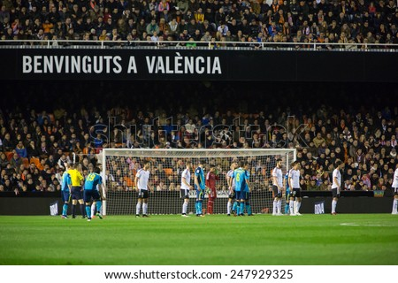 VALENCIA, SPAIN - JANUARY 25: Players both teams during Spanish League match between Valencia CF and Sevilla FC at Mestalla Stadium on January 25, 2015 in Valencia, Spain - stock photo