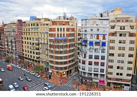 VALENCIA, SPAIN - JANUARY 3: Road traffic on main square of Valencia city on January 3, 2013. Valencia is the third largest city of Spain. - stock photo