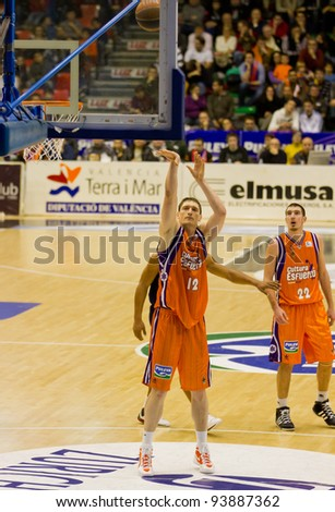 VALENCIA, SPAIN - JANUARY 28: Serhiy Lishchuk (#12 player) free shot during the ACB league match between Valencia Basket  and Asefa Estudiantes, 85-71, on January 28, 2012, in Valencia, Spain - stock photo
