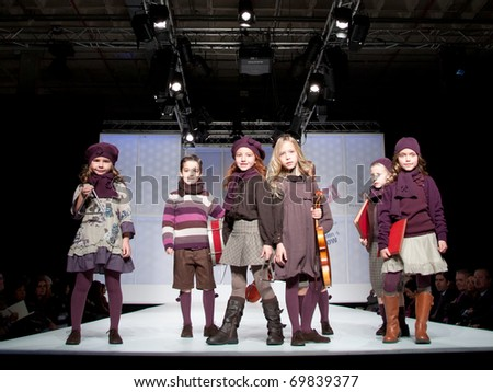 VALENCIA, SPAIN - JANUARY 21: Unidentified child models walk the runway at the FIMI Children's Winter Fashion Show for designer Condor in the Feria Valencia on January 21, 2011 in Valencia, Spain. - stock photo