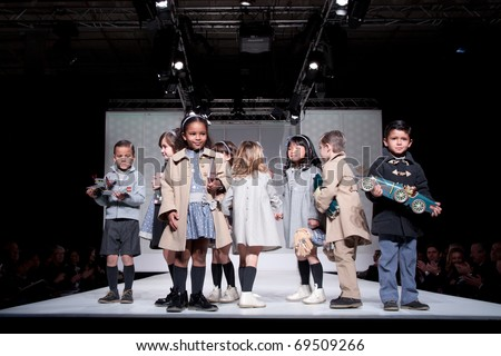 VALENCIA, SPAIN - JANUARY 21: unidentified children models at the FIMI Children's Winter Fashion Show with the designer Elisa Menuts in the Feria Valencia on January 21, 2011 in Valencia, Spain. - stock photo
