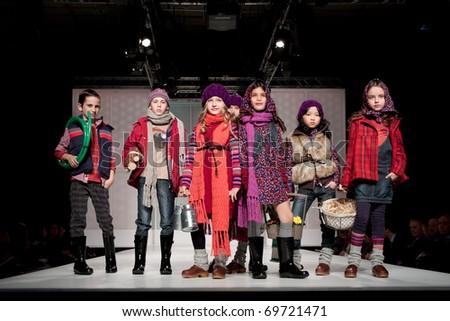 VALENCIA, SPAIN - JANUARY 21: unidentified children models at the FIMI Children's Winter Fashion Show with the designer Boboli in the Feria Valencia on January 21, 2011 in Valencia, Spain. - stock photo