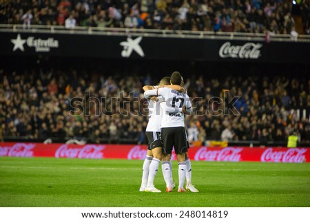 VALENCIA, SPAIN - JANUARY 25: Valencia players celebrating a goal during Spanish League match between Valencia CF and Sevilla FC at Mestalla Stadium on January 25, 2015 in Valencia, Spain - stock photo