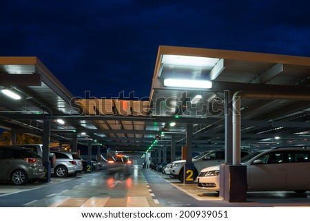 VALENCIA, SPAIN - JUNE 25, 2014: Inside the parking garage at the Valencia airport.  Situated 8 km from the city it is the 8th busiest Spanish airport with flight connections to 15 European countries. - stock photo