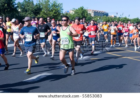VALENCIA, SPAIN - JUNE 20: Runners compete in the XII 6km Carrera Popular Tendetes run on June 20, 2010 in Valencia, Spain.