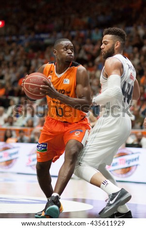 VALENCIA, SPAIN - JUNE 9th: Sato with ball and Taylor during 4th playoff match between Valencia Basket and Real Madrid at Fonteta Stadium on June 9, 2016 in Valencia, Spain - stock photo