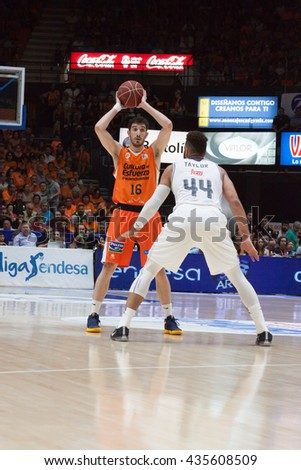VALENCIA, SPAIN - JUNE 9th: Vives (16) and Taylor during 4th playoff match between Valencia Basket and Real Madrid at Fonteta Stadium on June 9, 2016 in Valencia, Spain - stock photo