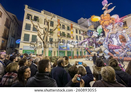 """VALENCIA, SPAIN - MARCH 15: Detailed view of """"El Pilar"""" falla with many tourists in """"Las Fallas"""" (""""the fires"""" in Valencian) exhibition on march 15, 2015 in Valencia, Spain - stock photo"""