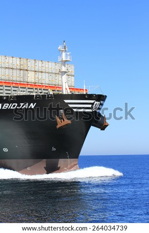 """VALENCIA, SPAIN â?? MARCH  07: Iron bulb in the bow zone of the container ship """"MSC ABIDJAN"""" sailing in open waters, on march 07, 2015 in Valencia. - stock photo"""