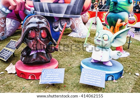 VALENCIA,SPAIN - MARCH 18: Las Fallas,papermache models are constructed then burnt in the traditional celebration in praise of St Joseph on March 18,2016 in Valencia,Spain. - stock photo