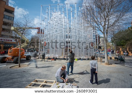 "VALENCIA, SPAIN - MARCH 15: Many workers assemble ""Nou Campanar"" falla for ""Las Fallas"" (""the fires"" in Valencian) exhibition on march 15, 2015 in Valencia, Spain - stock photo"