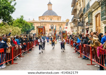 VALENCIA,SPAIN - MARCH 18: Several people walk in the offering of Fallas, one of the biggest parties in Spain on March 18,2016 in Valencia,Spain. - stock photo