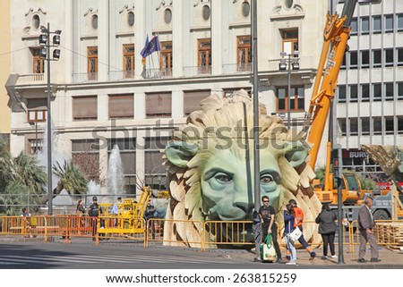 VALENCIA SPAIN-MARCH 10, 2015:  The city Hall square during the  construction of the falla manument  on March 10, 2015 in Valencia Spain.  - stock photo