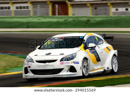 VALENCIA, SPAIN - MAY 2: Spanish driver Oscar Nogues races in a Opel Astra OPC in the TCR International Series, at Ricardo Tormo's Circuit, on May 2, 2015 in Cheste, Spain. - stock photo