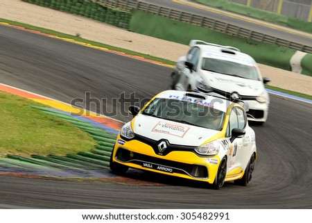 VALENCIA, SPAIN - MAY 2: Team formed by Santiago and Jose Luis Lopez Valdivieso races in a Renault Clio Cup IV in the Spanish Endurance Championship, at Ricardo Tormo's Circuit, on May 2, 2015. - stock photo