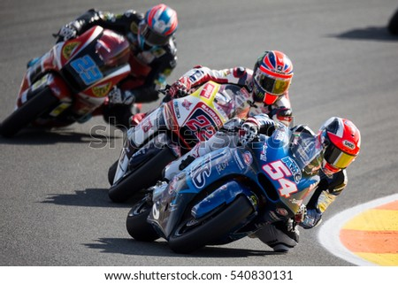 VALENCIA, SPAIN - NOV 13: 54 Pasini, 22 Lowes, 23 Schrotter in Moto2 Race during Motogp Grand Prix of the Comunidad Valencia on November 13, 2016 in Valencia, Spain.