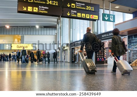 VALENCIA, SPAIN - NOVEMBER 17, 2014: Airline passengers inside the Valencia Airport. About 4.98 million passengers passed through the airport in 2013. - stock photo