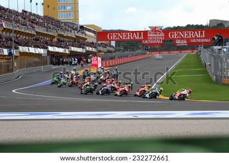 VALENCIA - SPAIN, NOVEMBER 9: First corner during race at 2014 Generali MotoGP of Valencia on November 9, 2014 - stock photo