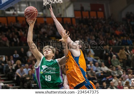 VALENCIA, SPAIN - NOVEMBER 23:  Kuzminskas (L) Lishchuk (R) during Spanish League game between Valencia Basket Club and Unicaja Malaga at Fonteta Stadium on November 23, 2014 in Valencia