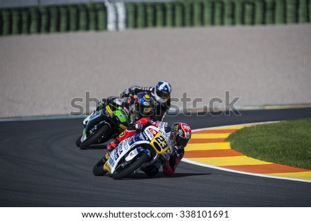 VALENCIA, SPAIN - NOVEMBER 6: Niccolo Antonelli, Zulfahmi Khairuddin and John Mcphee during Valencia MotoGP 2015 at Ricardo Tormo Circuit on November 6, 2015 in Valencia, Spain